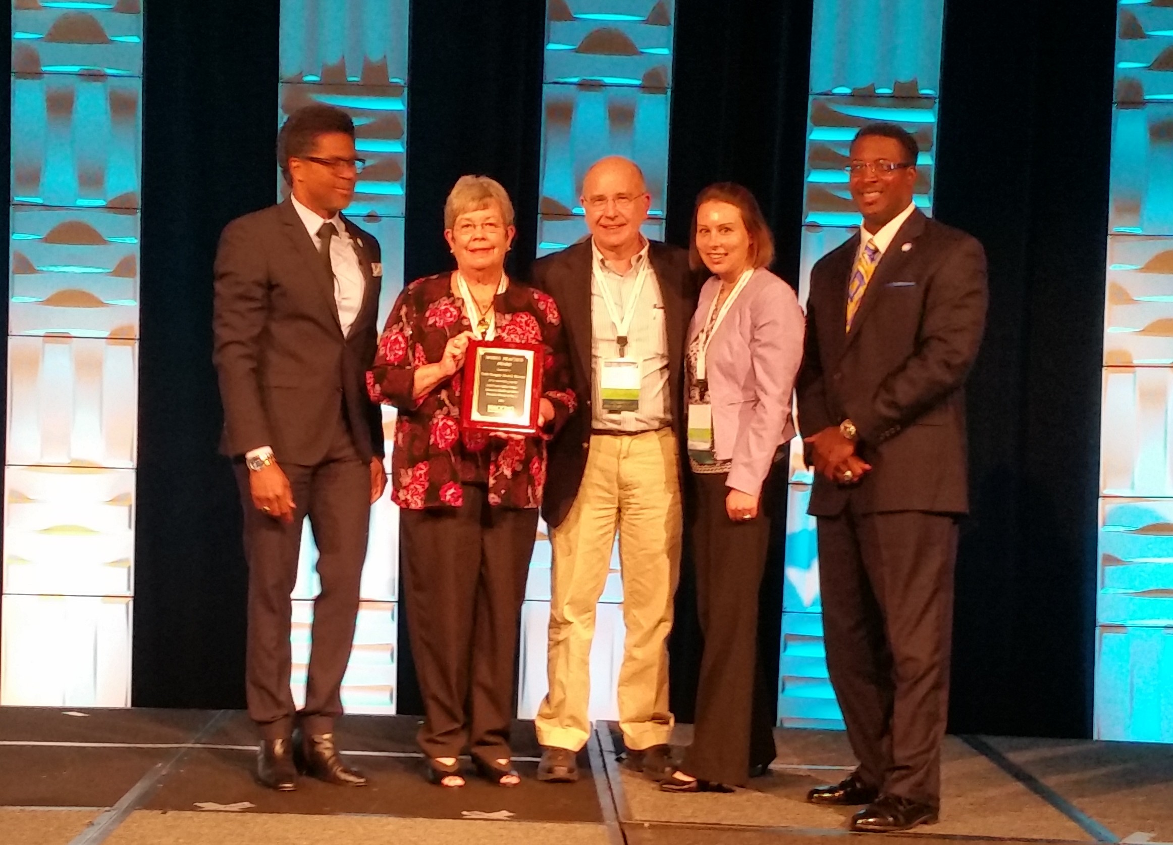 Accepting the Model Practice Award on July 8 (from L to R) Dr. LaMar Hasbrouck, NACCHO Executive Director, Pam Blackwell (CDPH), Dr. Jack Kennedy (CDPH), Emily Frantz (CDPH) and Dr. Swannie Jett, NACCHO President.